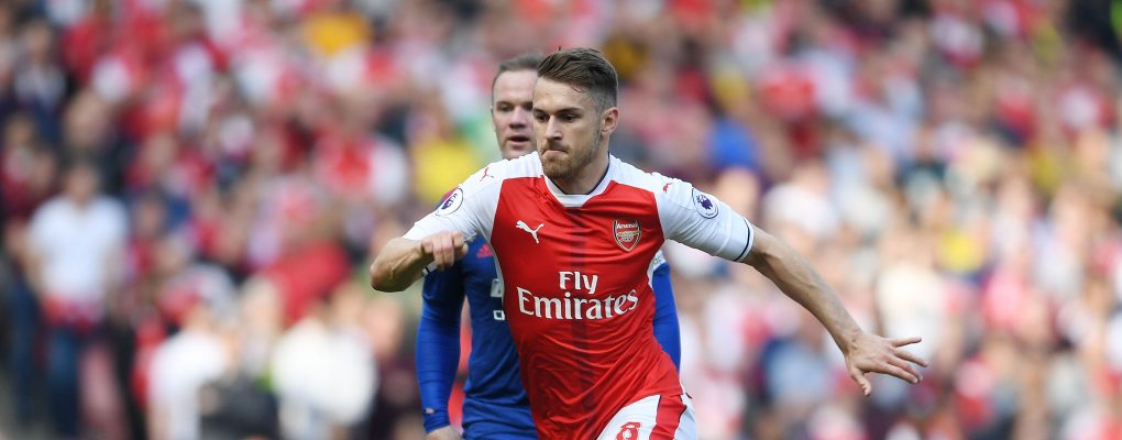 LONDON, ENGLAND - MAY 07:  Aaron Ramsey of Arsenal breaks past Wayne Rooney of Man United during the Premier League match between Arsenal and Manchester United at Emirates Stadium on May 7, 2017 in London, England.  (Photo by Stuart MacFarlane/Arsenal FC via Getty Images) *** Local Caption *** Aaron Ramsey;Wayne Rooney