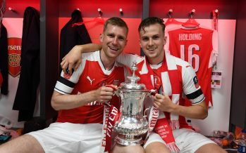 LONDON, ENGLAND - MAY 27: (L-R) Arsenal's Per Mertesacker and Rob Holding celebrate after the Emirates FA Cup Final between Arsenal and Chelsea at Wembley Stadium on May 27, 2017 in London, England. (Photo by Stuart MacFarlane/Arsenal FC via Getty Images) *** Local Caption *** Per Mertesacker;Rob Holding