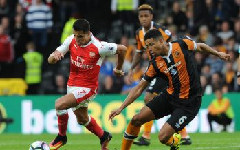 HULL, ENGLAND - SEPTEMBER 17:  Alexis Sanchez of Arsenal takes on Curtis Davies of Hull during the Premier League match between Hull City and Arsenal at KCOM Stadium on September 17, 2016 in Hull, England.  (Photo by David Price/Arsenal FC via Getty Images) *** Local Caption *** Alexis Sanchez; Curtis Davies