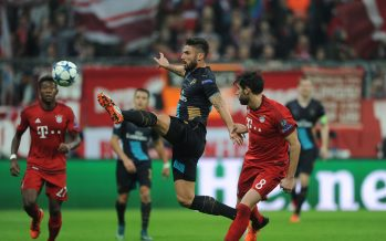 MUNICH, GERMANY - NOVEMBER 04:  Olivier Giroud of Arsenal holds off Javi Martinez of Bayern during the match between Bayern Munich and Arsenal on November 4, 2015 in Munich, Germany.  (Photo by David Price/Arsenal FC via Getty Images) *** Local Caption *** Olivier Giroud; Javi Martinez