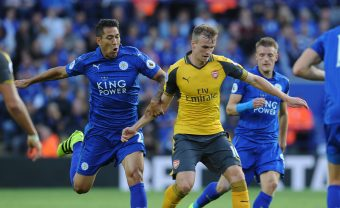 LEICESTER, ENGLAND - AUGUST 20: Rob Holding of Arsenal breaks past Leonarod Ulloa of Leicester during the Premier League match between Leicester City and Arsenal at The King Power Stadium on August 20, 2016 in Leicester, England. (Photo by Stuart MacFarlane/Arsenal FC via Getty Images) *** Local Caption *** Rob Holding;Leonardo Ulloa