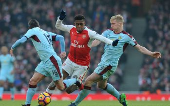 LONDON, ENGLAND - JANUARY 22:  Alex Iwobi of Arsenal is challenged by Ben Mee and Steven Defour of Burnley during the Premier League match between Arsenal and Burnley at Emirates Stadium on January 22, 2017 in London, England.  (Photo by David Price/Arsenal FC via Getty Images) *** Local Caption *** Aaron Ramsey; Steven Defour; Ben Mee