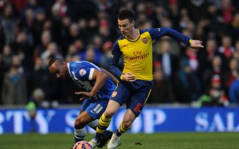 BRIGHTON, ENGLAND - JANUARY 25:  Laurent Koscielny of Arsenal breaks past Chris O'Grady of Brighton during the FA Cup Fourth Round match between Brighton & Hove Albion at Amex Stadium on January 25, 2015 in Brighton, England.  (Photo by Stuart MacFarlane/Arsenal FC via Getty Images) *** Local Caption *** Laurent Koscielny;Chris O'Grady