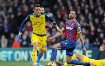LONDON, ENGLAND - FEBRUARY 21: Mesut Ozil of Arsenal breaks past Damien Delaney of Crystal Palace during the Barclays Premier League match between Crystal Palace and Arsenal at Selhurst Park on February 21, 2015 in London, England. Stuart MacFarlane/Arsenal FC via Getty Images)  *** Local Caption *** Mesut Ozil;Oezil;Damien Delaney