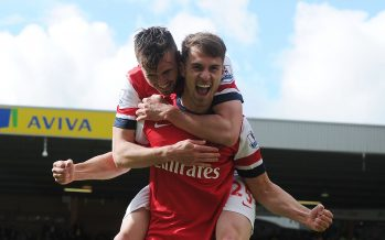 NORWICH, ENGLAND - MAY 11:  Arsenal's Aaron Ramsey celebrates his goal with Carl Jenkinson during the Barclays Premier League match between Norwich City and Arsenal at Carrow Road on May 11, 2014 in Norwich, England.  (Photo by Stuart MacFarlane/Arsenal FC via Getty Images) *** Local Caption *** Aaron Ramsey;Carl Jenkinson