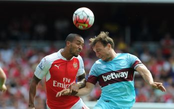LONDON, ENGLAND - AUGUST 09:  Theo Walcott of Arsenal takes on Mark Noble of West Ham during the Barclays Premier League match between Arsenal and West Ham United at  (Photo by David Price/Arsenal FC via Getty Images) *** Local Caption *** Theo Walcott; Mark Noble