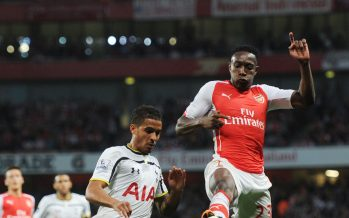 LONDON, ENGLAND - SEPTEMBER 27:  Danny Welbeck of Arsenal challenged by Kyle Naughton of Tottenham during the Barclays Premier League match between Arsenal and Tottenham at Emirates Stadium on September 27, 2014 in London, England.  (Photo by Stuart MacFarlane/Arsenal FC via Getty Images) *** Local Caption *** Danny Welbeck;Kyle Naughton