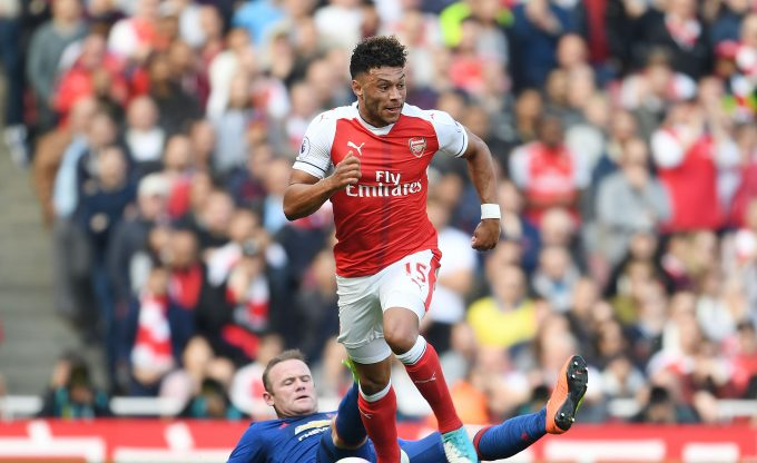 LONDON, ENGLAND - MAY 07:  Alex Oxlade-Chamberlain of Arsenal breaks past Wayne Rooney of Man United during the Premier League match between Arsenal and Manchester United at Emirates Stadium on May 7, 2017 in London, England.  (Photo by Stuart MacFarlane/Arsenal FC via Getty Images) *** Local Caption *** Alex Oxlade-Chamberlain;Wayne Rooney