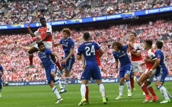 LONDON, ENGLAND - MAY 27:  Danny Welbeck of Arsenal jumps above Diego Costa and Marcos Alonso of Chelsea during the match between Arsenal and Chelsea at Wembley Stadium on May 27, 2017 in London, England.  (Photo by David Price/Arsenal FC via Getty Images) *** Local Caption *** Danny welbeck; Diego Costa; Marcos Alonso