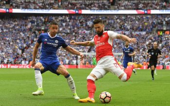 LONDON, ENGLAND - MAY 27:  Olivier Giroud crosses past Chelsea defender Gary Cahill for Aaron Ramsey to score the 2nd Arsenal goal during the Emirates FA Cup Final between Arsenal and Chelsea at Wembley Stadium on May 27, 2017 in London, England.  (Photo by Stuart MacFarlane/Arsenal FC via Getty Images) *** Local Caption *** Olivier Giroud;Gary Cahill;Aaron Ramsey