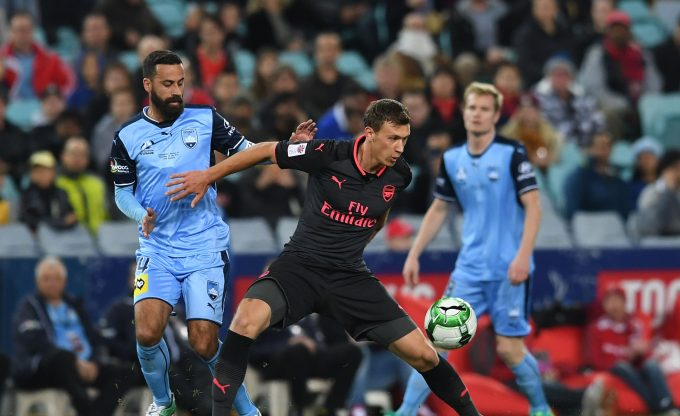 SYDNEY, AUSTRALIA - JULY 13:  Krystian Bielik of Arsenal takes on Alex Brosque of Sydney FC during the match between Sydney FC and Arsenal at ANZ Stadium on July 13, 2017 in Sydney, Australia.  (Photo by David Price/Arsenal FC via Getty Images) *** Local Caption *** Krystain Bielik; Alex Brosque