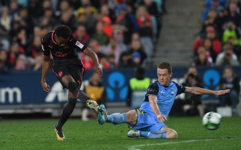 SYDNEY, AUSTRALIA - JULY 13:  Joe Willock of Arsenal shoots under pressure from Brandon O'Neill of Sydney FC during the match between Sydney FC and Arsenal at ANZ Stadium on July 13, 2017 in Sydney, Australia.  (Photo by David Price/Arsenal FC via Getty Images) *** Local Caption *** Joe Willock; Brandon O'Neill