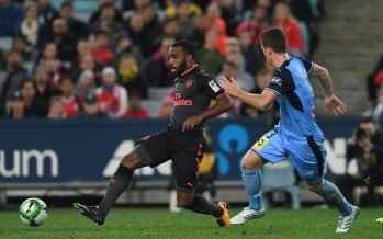 SYDNEY, AUSTRALIA - JULY 13:  Alexandre Lacazette of Arsenal passes the ball under pressure from Brandon O'Neill of Sydney during the match between Sydney FC and Arsenal at ANZ Stadium on July 13, 2017 in Sydney, Australia.  (Photo by David Price/Arsenal FC via Getty Images) *** Local Caption *** Alexandre Lacazette; Brandon O'Neill