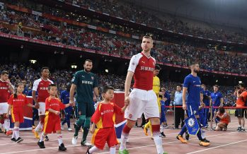 BEIJING, CHINA - JULY 22:  Per Mertesacker of Arsenal leads the team out before the match between Arsenal and Chelsea at Birds Nest on July 22, 2017 in Beijing, China.  (Photo by David Price/Arsenal FC via Getty Images) *** Local Caption *** Per Mertesacker