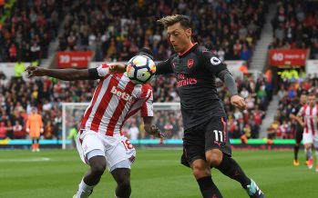 STOKE ON TRENT, ENGLAND - AUGUST 19:  Mesut Ozil of Arsenal takes on Mame Diouf of Stoke during the Premier League match between Stoke City and Arsenal at Bet365 Stadium on August 19, 2017 in Stoke on Trent, England.  (Photo by Stuart MacFarlane/Arsenal FC via Getty Images) *** Local Caption *** Mesut Ozil;Oezil;Mame Diouf