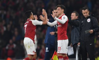 LONDON, ENGLAND - SEPTEMBER 25: Arsenal substitute Mesut Ozil comes on for Alexis Sanchez during the Premier League match between Arsenal and West Bromwich Albion at Emirates Stadium on September 25, 2017 in London, England. (Photo by Stuart MacFarlane/Arsenal FC via Getty Images) *** Local Caption *** Mesut Ozil;Oeizl;Alexis Sanchez
