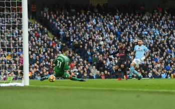MANCHESTER, ENGLAND - NOVEMBER 05: Alex Lacazette shoots past Man City goalkeeper Ederson to score the Arsenal goal during the Premier League match between Manchester City and Arsenal at Etihad Stadium on November 5, 2017 in Manchester, England. (Photo by Stuart MacFarlane/Arsenal FC via Getty Images) *** Local Caption *** Alex Lacazette;Ederson