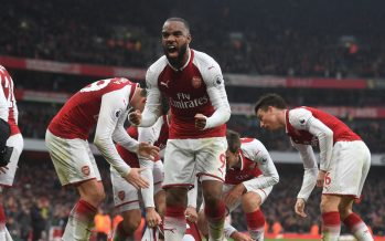 LONDON, ENGLAND - NOVEMBER 18: Alex Lacazette celebrates the 1st Arsenal goal scored by Shkodran Mustafi during the Premier League match between Arsenal and Tottenham Hotspur at Emirates Stadium on November 18, 2017 in London, England. (Photo by Stuart MacFarlane/Arsenal FC via Getty Images) *** Local Caption *** Alex Lacazette