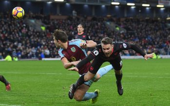 BURNLEY, ENGLAND - NOVEMBER 26: Aaron Ramsey is bundled to the ground by Burnley defender James Tarkowski for the Arsenal penalty during the Premier League match between Burnley and Arsenal at Turf Moor on November 26, 2017 in Burnley, England. (Photo by Stuart MacFarlane/Arsenal FC via Getty Images) *** Local Caption *** Aaron Ramsey; James Tarkowski