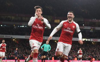 LONDON, ENGLAND - NOVEMBER 29:  (L) Mesut Ozil celebrates scoring the 4th Arsenal goal with (R) Sead Kolasinac during the Premier League match between Arsenal and Huddersfield Town at Emirates Stadium on November 29, 2017 in London, England.  (Photo by Stuart MacFarlane/Arsenal FC via Getty Images) *** Local Caption *** Mesut Ozil;Oezil;Sead Kolasinac