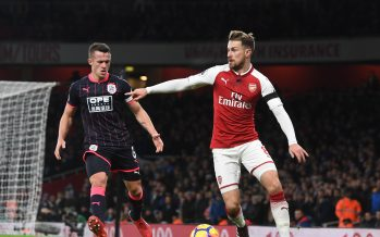 LONDON, ENGLAND - NOVEMBER 29:  Aaron Ramsey of Arsenal takes on Jonathan Hogg of Huddersfield during the Premier League match between Arsenal and Huddersfield Town at Emirates Stadium on November 29, 2017 in London, England.  (Photo by Stuart MacFarlane/Arsenal FC via Getty Images) *** Local Caption *** Aaron Ramsey;Jonathan Hogg