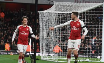 LONDON, ENGLAND - NOVEMBER 29:  (L-R) Mesut Ozil and Aaron Ramsey celebrate the 3rd Arsenal goal, scored by Alexis Sanchez during the Premier League match between Arsenal and Huddersfield Town at Emirates Stadium on November 29, 2017 in London, England.  (Photo by Stuart MacFarlane/Arsenal FC via Getty Images) *** Local Caption *** Mesut Ozil;Oezil;Aaron Ramsey