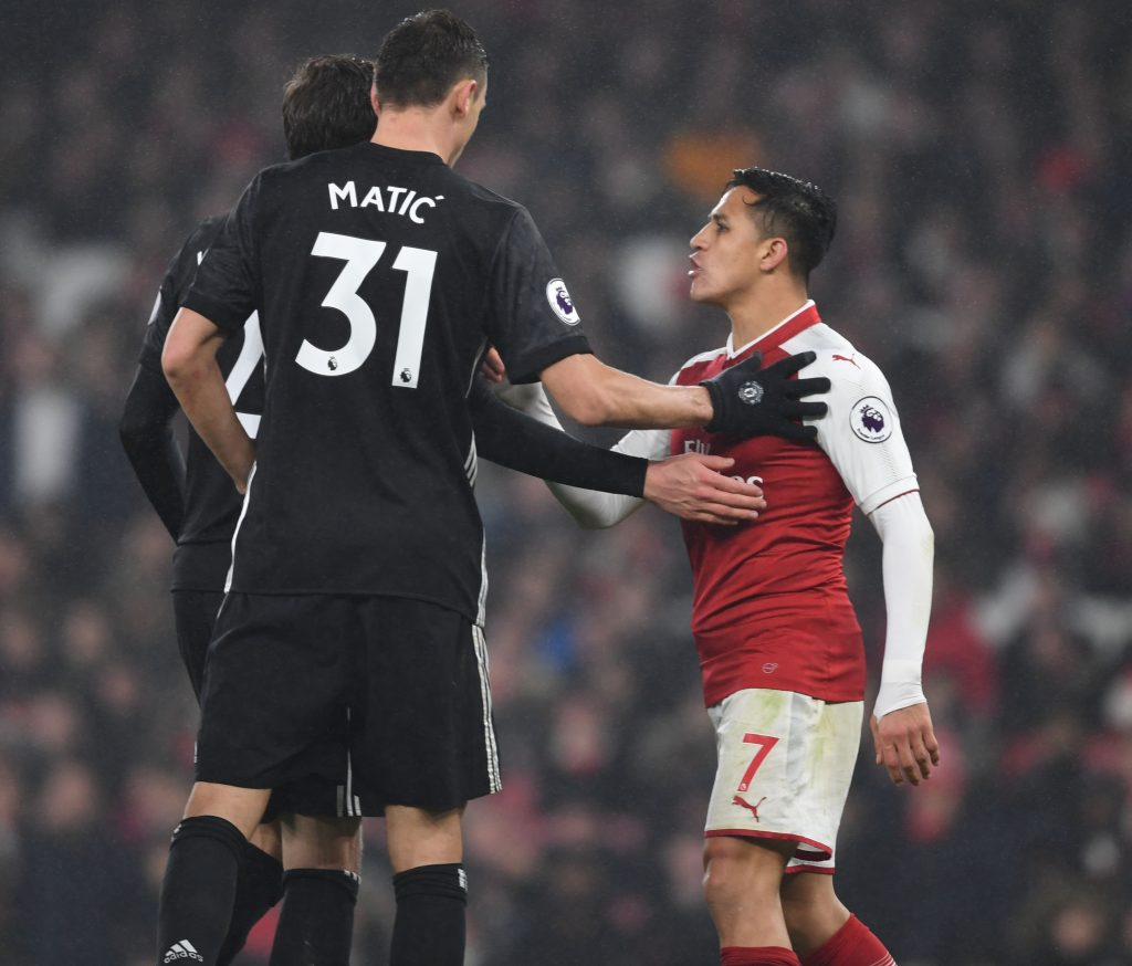 LONDON, ENGLAND - DECEMBER 02: Arsenal's Alexis Sanchez clashes with Nemanja Matic of Man United during the Premier League match between Arsenal and Manchester United at Emirates Stadium on December 2, 2017 in London, England. (Photo by Stuart MacFarlane/Arsenal FC via Getty Images) *** Local Caption *** Alexis Sanchez;Nemanja Matic