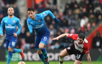 SOUTHAMPTON, ENGLAND - DECEMBER 09:  Mesut Ozil of Arsenal takes on Pierre-Emile Hojbjerg of Southampton during the Premier League match between Southampton and Arsenal at St Mary's Stadium on December 10, 2017 in Southampton, England.  (Photo by David Price/Arsenal FC via Getty Images) *** Local Caption *** Mesut Ozil; Oezil; Pierre-Emile Hojbjerg