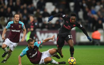 LONDON, ENGLAND - DECEMBER 13:  Danny Welbeck of Arsenal is challenged by Winston Reid of West Ham during the Premier League match between West Ham United and Arsenal at London Stadium on December 13, 2017 in London, England.  (Photo by David Price/Arsenal FC via Getty Images) *** Local Caption *** Danny Welbeck; Winston Reid
