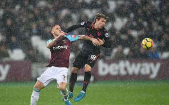 LONDON, ENGLAND - DECEMBER 13:  Nacho Monreal of Arsenal heads the ball under pressure from Marko Arnautovic of West Ham during the Premier League match between West Ham United and Arsenal at London Stadium on December 13, 2017 in London, England.  (Photo by David Price/Arsenal FC via Getty Images) *** Local Caption *** Nacho Monreal; Marko Arnautovic