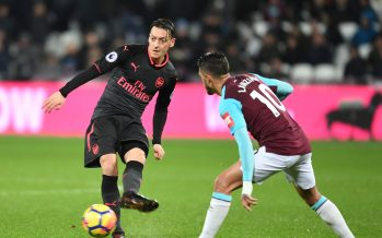 LONDON, ENGLAND - DECEMBER 13: Mesut Ozil of Arsenal takes on Manuel Lanzini of West Ham during the Premier League match between West Ham United and Arsenal at London Stadium on December 13, 2017 in London, England. (Photo by Stuart MacFarlane/Arsenal FC via Getty Images) *** Local Caption *** Mesut Ozil;Oezil;Manuel Lanzini