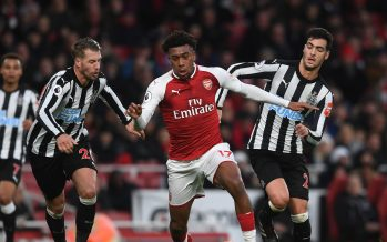 LONDON, ENGLAND - DECEMBER 16:  Alex Iwobi of Arsenal takes on Florian Lejeune and Mikel Merino of Newcastle during the Premier League match between Arsenal and Newcastle United at Emirates Stadium on December 16, 2017 in London, England.  (Photo by David Price/Arsenal FC via Getty Images) *** Local Caption *** Alex Iwobi; Mikel Merino; Florian Lejeune