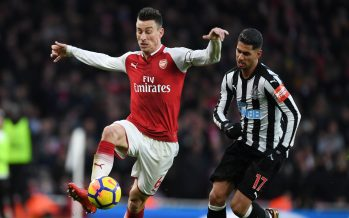 LONDON, ENGLAND - DECEMBER 16:  Laurent Koscielny of Arsenal takes on Ayoze Perez of Newcastle during the Premier League match between Arsenal and Newcastle United at Emirates Stadium on December 16, 2017 in London, England.  (Photo by Stuart MacFarlane/Arsenal FC via Getty Images) *** Local Caption *** Laurent Koscielny; Ayoze Perez