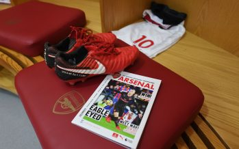 LONDON, ENGLAND - JANUARY 20:  Jack Wilshere's boots and the matchday programme in the Arsenal changing room before the Premier League match between Arsenal and Crystal Palace at Emirates Stadium on January 20, 2018 in London, England.  (Photo by Stuart MacFarlane/Arsenal FC via Getty Images) *** Local Caption *** Jack Wilshere