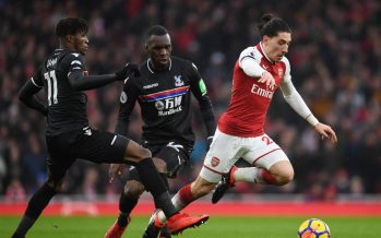 LONDON, ENGLAND - JANUARY 20: Hector Bellerin of Arsenal breaks past (L) Wilfred Zaha and (2ndL) Christian Benteke of Crystal Palace during the Premier League match between Arsenal and Crystal Palace at Emirates Stadium on January 20, 2018 in London, England. (Photo by Stuart MacFarlane/Arsenal FC via Getty Images) *** Local Caption *** Hector Bellerin;Wilfred Zaha;Christian Benteke