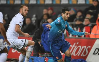 SWANSEA, WALES - JANUARY 30: Henrikh Mkhitaryan of Arsenal takes on Mike van der Hoorn of Swansea during the Premier League match between Swansea City and Arsenal at Liberty Stadium on January 30, 2018 in Swansea, Wales. (Photo by Stuart MacFarlane/Arsenal FC via Getty Images) *** Local Caption *** Henrikh Mkhitaryan;Mike van der Hoorn