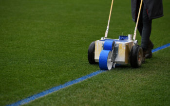 LONDON, ENGLAND - MARCH 01:  The Arsenal groundstaff mark out the pitch with blue paint before the Premier League match between Arsenal and Manchester City at Emirates Stadium on March 1, 2018 in London, England.  (Photo by David Price/Arsenal FC via Getty Images) *** Local Caption *** Arsenal groundstaff