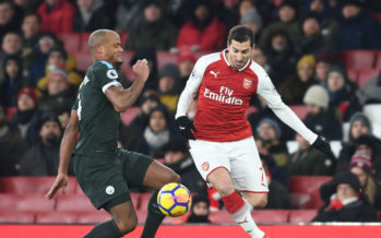 LONDON, ENGLAND - MARCH 01: Henrikh Mkhitaryan of Arsenal takes on Vincent Kompany of Man City during the Premier League match between Arsenal and Manchester City at Emirates Stadium on March 1, 2018 in London, England. (Photo by Stuart MacFarlane/Arsenal FC via Getty Images) *** Local Caption *** Henrikh Mkhitaryan;Vincent Kompany