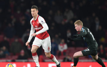 LONDON, ENGLAND - MARCH 01: Laurent Koscielny of Arsenal breaks past Kevin De Bruyne of Man City during the Premier League match between Arsenal and Manchester City at Emirates Stadium on March 1, 2018 in London, England. (Photo by Stuart MacFarlane/Arsenal FC via Getty Images) *** Local Caption *** Laurent Koscielny;Kevin De Bruyne