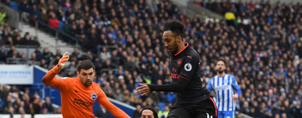 BRIGHTON, ENGLAND - MARCH 04:  Pierre-Emerick Aubameyang of Arsenal skips past Matthew Ryan and Ezequiel Schelotto of Brighton during the Premier League match between Brighton and Hove Albion and Arsenal at Amex Stadium on March 4, 2018 in Brighton, England.  (Photo by David Price/Arsenal FC via Getty Images) *** Local Caption *** Pierre-Emerick Aubameyang; Ezequiel Schelotto; Matthew Ryan