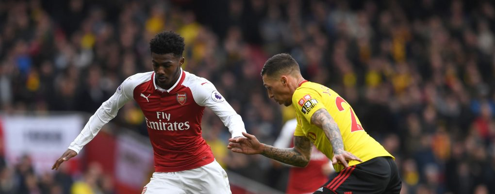 LONDON, ENGLAND - MARCH 11:  Ainsley Maitland-Niles of Arsenal is challenged by Jose Holebas of Watford during the Premier League match between Arsenal and Watford at Emirates Stadium on March 11, 2018 in London, England.  (Photo by David Price/Arsenal FC via Getty Images) *** Local Caption *** Ainsley Maitland-Niles; Jose Holebas