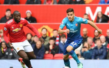 MANCHESTER, ENGLAND - APRIL 29:  Konstantinos Mavropanos of Arsenal breaks past Romelu Lukaku of Man United during the Premier League match between Manchester United and Arsenal at Old Trafford on April 29, 2018 in Manchester, England. (Photo by Stuart MacFarlane/Arsenal FC via Getty Images) *** Local Caption *** Konstantinos Mavropanos;Romelu Lukaku