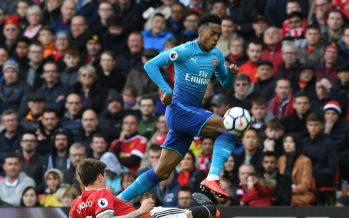 MANCHESTER, ENGLAND - APRIL 29:  Joe Willock of Arsenal breaks past Victor Lindelof of Man United during the Premier League match between Manchester United and Arsenal at Old Trafford on April 29, 2018 in Manchester, England.  (Photo by Stuart MacFarlane/Arsenal FC via Getty Images) *** Local Caption *** Joe Willock;Victor Lindelof