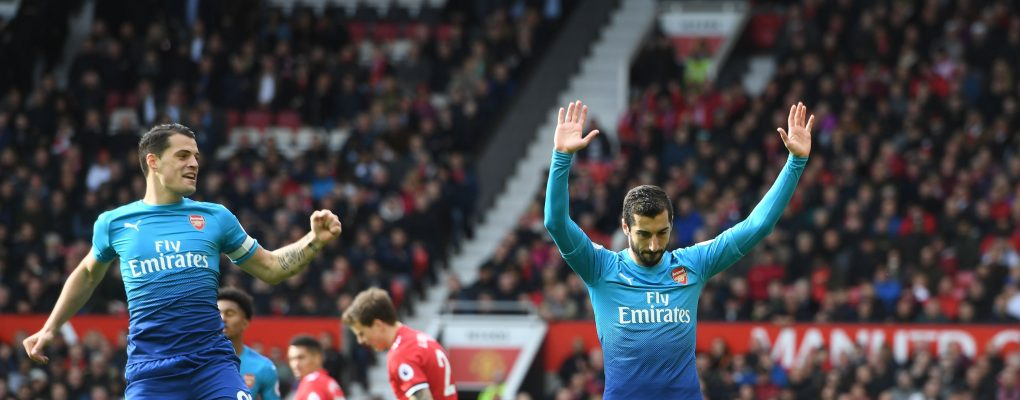 MANCHESTER, ENGLAND - APRIL 29:  (R) Henrikh Mkhitaryan celebrates scoring the Arsenal goal with (L) Granit Xhaka during the Premier League match between Manchester United and Arsenal at Old Trafford on April 29, 2018 in Manchester, England.  (Photo by Stuart MacFarlane/Arsenal FC via Getty Images) *** Local Caption *** Henrikh Mkhitaryan;Granit Xhaka