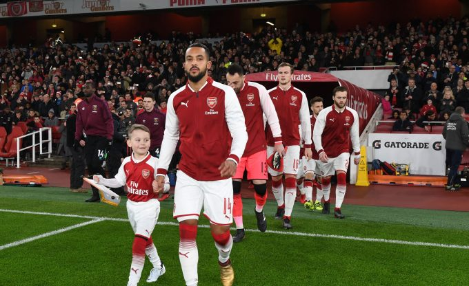 LONDON, ENGLAND - DECEMBER 19:  Arsenal captain Theo Walcott leads out the team before the Carabao Cup Quarter Final match between Arsenal and West Ham United at Emirates Stadium on December 19, 2017 in London, England.  (Photo by Stuart MacFarlane/Arsenal FC via Getty Images) *** Local Caption *** Theo Walcott