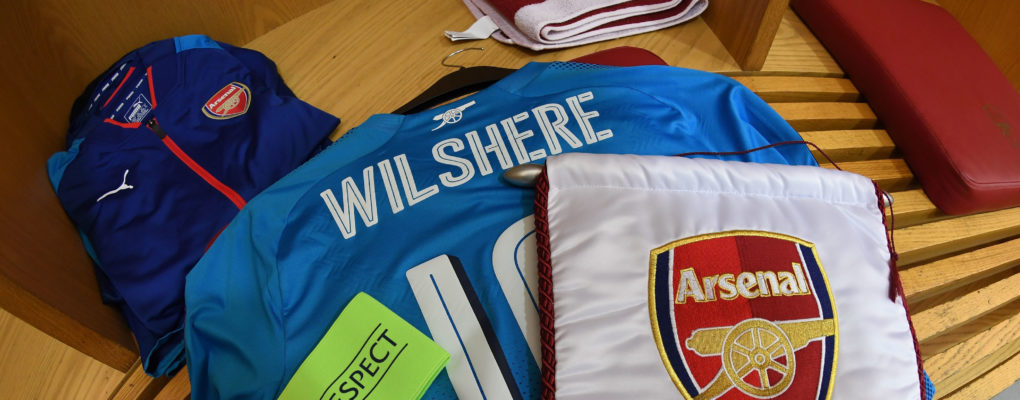 LONDON, ENGLAND - FEBRUARY 22:  Jack Wilshere's Arsenal shirt hangs with the match pennant in the changingroom before the UEFA Europa League Round of 32 match between Arsenal and Ostersunds FK at the Emirates Stadium on February 22, 2018 in London, United Kingdom.  (Photo by David Price/Arsenal FC via Getty Images) *** Local Caption *** Jack Wilshere; Pennant