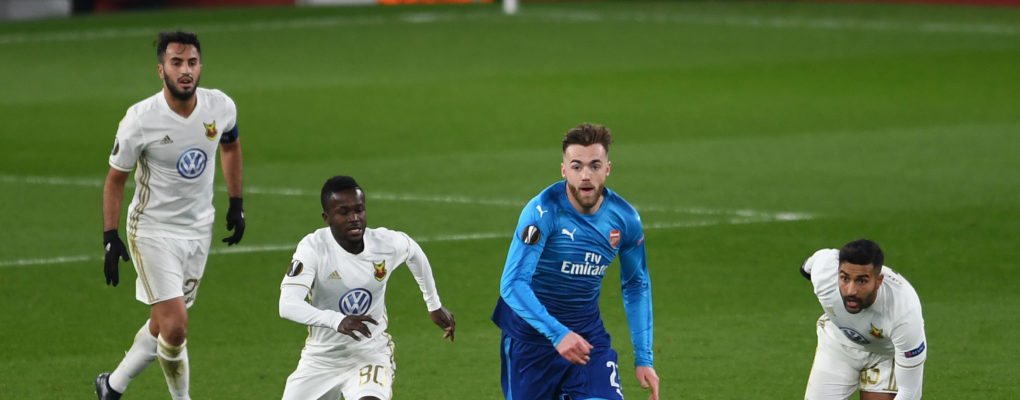 LONDON, ENGLAND - FEBRUARY 22:  Calum Chambers of Arsenal takes on Frank Arhin of Ostersunds during UEFA Europa League Round of 32 match between Arsenal and Ostersunds FK at the Emirates Stadium on February 22, 2018 in London, United Kingdom.  (Photo by David Price/Arsenal FC via Getty Images) *** Local Caption *** Calum Chambers; Frank Arhin