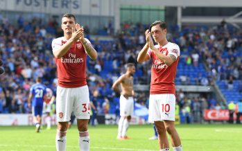 CARDIFF, WALES - SEPTEMBER 02:  (L) Granit Xhaka and (R) Mesut Ozil applaud the Arsenal fans after the Premier League match between Cardiff City and Arsenal  at Cardiff City Stadium on September 2, 2018 in Cardiff, United Kingdom.  (Photo by Stuart MacFarlane/Arsenal FC via Getty Images) *** Local Caption *** Granit Xhaka;Mesut Ozil;Oezil