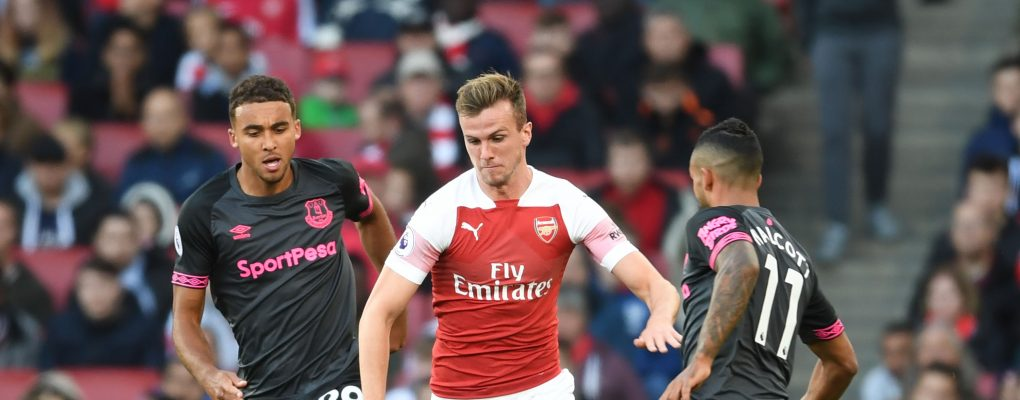 LONDON, ENGLAND - SEPTEMBER 23:  Rob Holding of Arsenal takes on (L) Domonic Calvert-Lewin and (R) Theo Walcott during the Premier League match between Arsenal FC and Everton FC at Emirates Stadium on September 23, 2018 in London, United Kingdom.  (Photo by Stuart MacFarlane/Arsenal FC via Getty Images) *** Local Caption *** Rob Holding;Domonic Calvert-Lewin;Theo Walcott