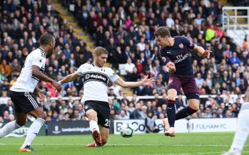 LONDON, ENGLAND - OCTOBER 07:  Aaron Ramsey scotres Arsenal's 3rd goal under pressure from Maxime Le Marchard of Fulham during the Premier League match between Fulham FC and Arsenal FC at Craven Cottage on October 7, 2018 in London, United Kingdom.  (Photo by David Price/Arsenal FC via Getty Images) *** Local Caption *** Maxime Le Marchard; Aaron Ramsey